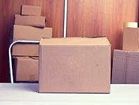 lot of brown cardboard boxes, the process of packing things when moving, help, volunteering.