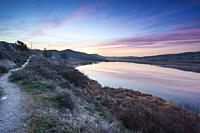Track, hills and dawn at Ontigola lagoon. Aranjuez. Madrid. Spain. Europe.
