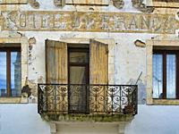 wrought iron balcony and faded sign on HOtel de France, Casseneuil, Lot-et-Garonne Department, Nouvelle-Aquitaine, France.