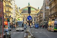 France. Sunny summer day in Paris. Traffic on one of the main streets. Lots of tourist buses and cars.