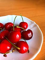 Cherries in a dish.
