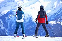 Two skiers enjoy the view.