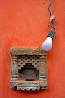 light bulb on red wall, Blanes, Catalonia, Spain