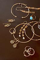 Various golden jewelry pieces.
