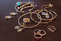 Various golden jewelry items.