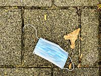 Tilburg, Netherlands. Trown Away of Lost Corona FaceMask lying around on the Pavement of the Street.