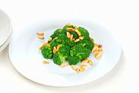 fresh and vivid sauteed broccoli and almonds very ealthy food.