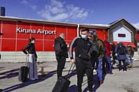 Kiruna, Sweden Passengers arrive with an SAS flight from Stockholm at Kiruna airport wearing obligatory masks.