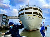 Rotterdam, Netherlands. Mooring down the Waterbus on Dock, just behind the Historical Vessel, the SS Rotterdam.