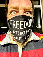 """Moergestel, Tilburg. Selfie wearing a Corona Facemask with the Phrase: """"""""Freedom does not look like this!""""""""."""