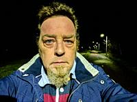 Tilburg, Netherlands. Mature adult caucasian male strolling outdoors after Corona Curfew Hours.