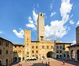 San Gimignano, Siena Province, Tuscany, Italy. Piazza del Duomo. The historic centre of San Gimignano is a UNESCO World Heritage Site.