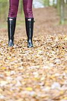 black women's boots in the autumn landscape.