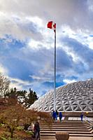 Canadian flag flying over the Bloedel Convervatory dome in Queen Elizabeth Park Vanvouver British Columbia.