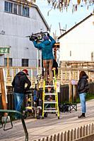 Cameraman in action during filming of a Korean movie in Steveston British Columbia Canada.