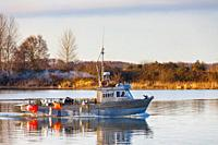 Small commercial fishing vessel heading out of Steveston Harbour in British Columbia Canada.