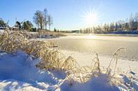 Wassara river in Gällivare town in winter season, frozen river and direct light, Gällivare, Swedish Lapland, Sweden.