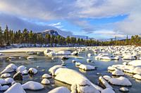 Winter in Stora sjöfallet nationalpark with snowy rocks in the water, snowy mountain in background, Stora sjöfallet nationalpark, Swedish Lapland, Swe...