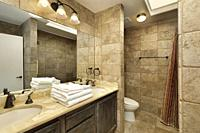 Bathroom in upscale home with marble vanity and skylight.