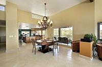 Eating area in luxury home with picture windows.