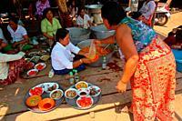 Woman prepare food for the monks at kampong Phulk, tonle sap lake, siem reap, cambodia
