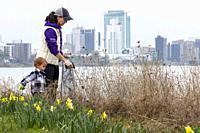Detroit, Michigan - Volunteers clean trash from Belle Isle State Park as part of Earth Week Spring Cleanup.