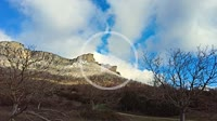 Mountain range with clouds in a countryside time lapse view. Loquiz mountain range. Navarre, Spain, Europe.