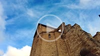 Church facade and sky with clouds in a time lapse view. San Miguel church. Estella, Navarre, Spain, Europe.