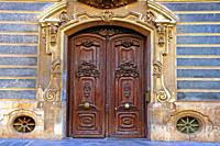side door of the Palau del Marquès de Dosaigües, Baroque and Rococo civil building, home of the Museum of Ceramics, Valencia, Spain