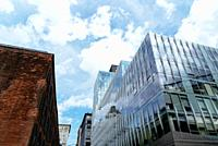 Cityscape with old and new buildings in Brooklyn, New York. Technology and Financial companies. Modern workspaces and rental concepts.