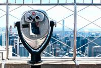 Old Binoculars Against Cityscape of New York. Travel and wanderlust, search or curiosity concepts.