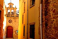 Narrow alley and bell-gable in Fermoselle, Zamora, Spain.