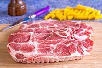 raw pork chop in a closeup.