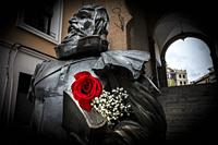 Spanish writer Cervantes sculpture with a rose flower symbol of the day of the book. Toledo. Spain.