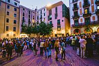 People gathering in the Square de les Moreres in Barcelona to mark the beginning of the Catalan Weekend celebrations on 10th September 2015. This squa...