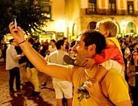 Afather takes a selfie with his young son in the Square de les Moreres in Barcelona. This square contains the memorial to those who perished in the 17...