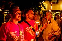 A torchlight procession marks the beginning of the Catalan Weekend celebrations in the Square de les Moreres in Barcelona. This square contains the me...