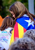 A young girl draped in the Estelada in Barcelona Catalonia, Spain during the Catalan National Day celebrations for independence on 11th September 2015...