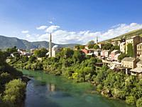 Mostar, Herzegovina-Neretva, Bosnia and Herzegovina. Neretva River, Koski Mehmed-Pasha Mosque and old town seen from the Old Bridge. The Old Bridge Ar...