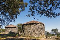 Citania de Briteiros, Braga District, Portugal. Iron Age settlement. Two reconstructed stone houses. One of Portugal's most important archeological si...