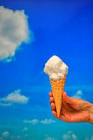 Concept Ice cream cone and Cotton like Clouds.