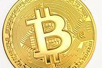 Galati, Romania - April 12, 2021 Studio shot of golden Bitcoin currency.