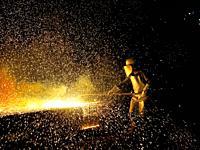 Industrial welder worker in steel plant.