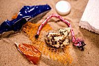 plastic pollution on a beach.