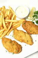 british traditional fish and chips meal on white plate.