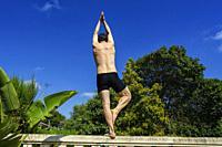 A man practicing yoga on a railing doing balance, Valencia, Spain