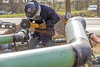 Detroit, Michigan - Contractors for DTE Energy replace old cast iron and bare steel natural gas pipes. The utility is in the midst of a 25-year plan t...