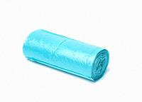 blue plastic trash bags with strings isolated on white background, close up.