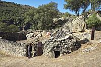 """Some visitors take a picture in the goat pen and chivitero of the Ethnographic Museum """""""" La Majada del Rostro """""""". Shepherd's sheepfold where a goat he..."""