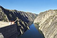 Two girls contemplate the spectacular landscape of the Arribes del Duero from the Mirador de la Central Eléctrica. while one of them points a finger a...